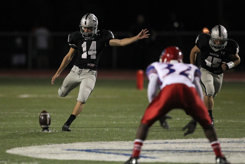 Martin kicker Ben Grogan (14) kicks off against Sam Houston in high school football action at Cravens Field in Arlington, Texas Friday night, November 2, 2012. (Brad Loper/The Dallas Morning News) ORG XMIT: DMN1211022145410649
