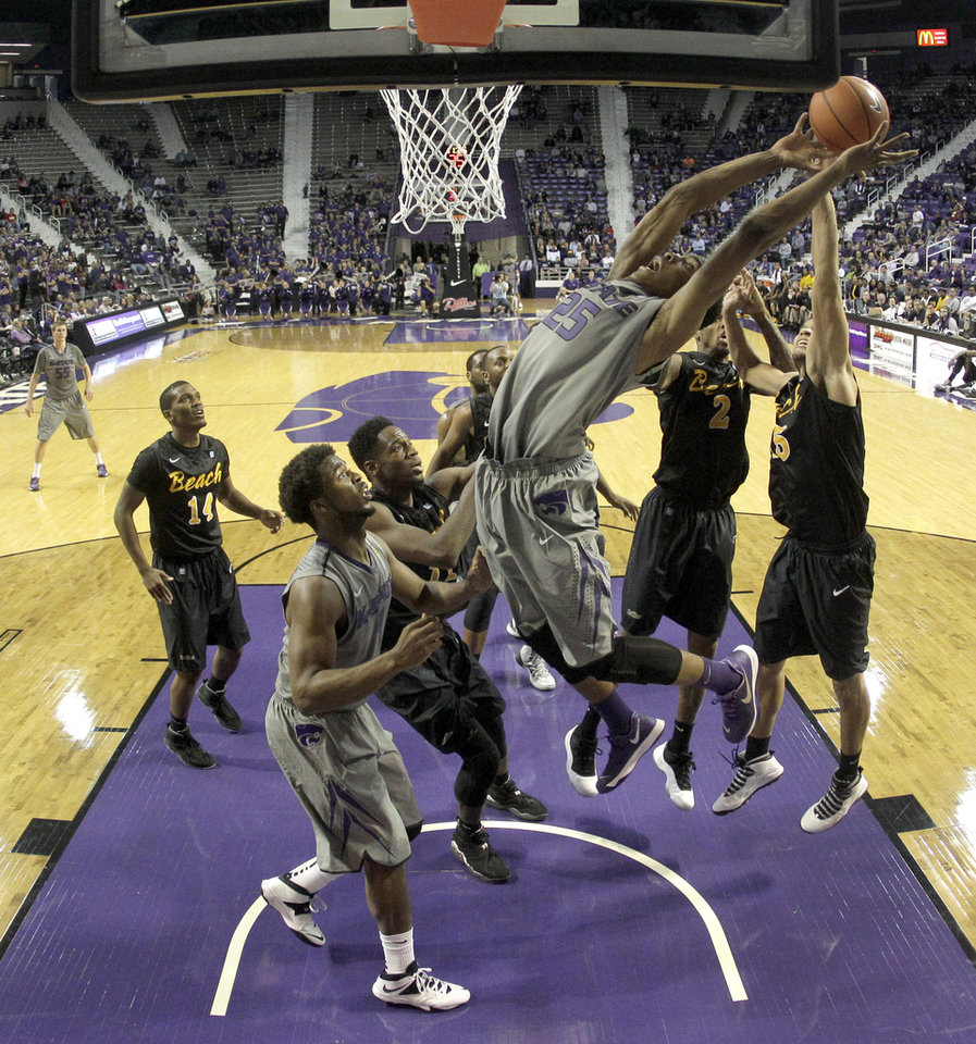 Photo - Kansas State's Wesley Iwundu (25) puts up a shot during the second half of an NCAA college basketball game against Long Beach State, Sunday, Nov. 17, 2013, in Manhattan, Kan. Kansas State won 71-58. (AP Photo/Charlie Riedel)