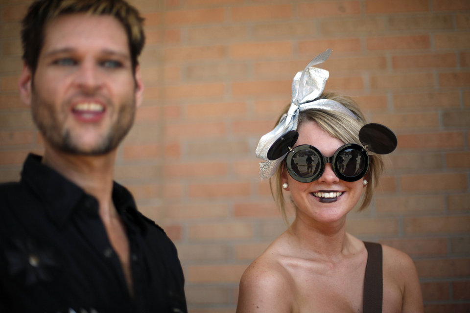 Brad Wickware, left, of Tulsa, Okla., and Bailee Wynn of Purcell, Okla., wait outside the Ford Center for the Lady Gaga concert in Oklahoma City on Tuesday, July 20, 2010.  Photo by Bryan Terry, The Oklahoman