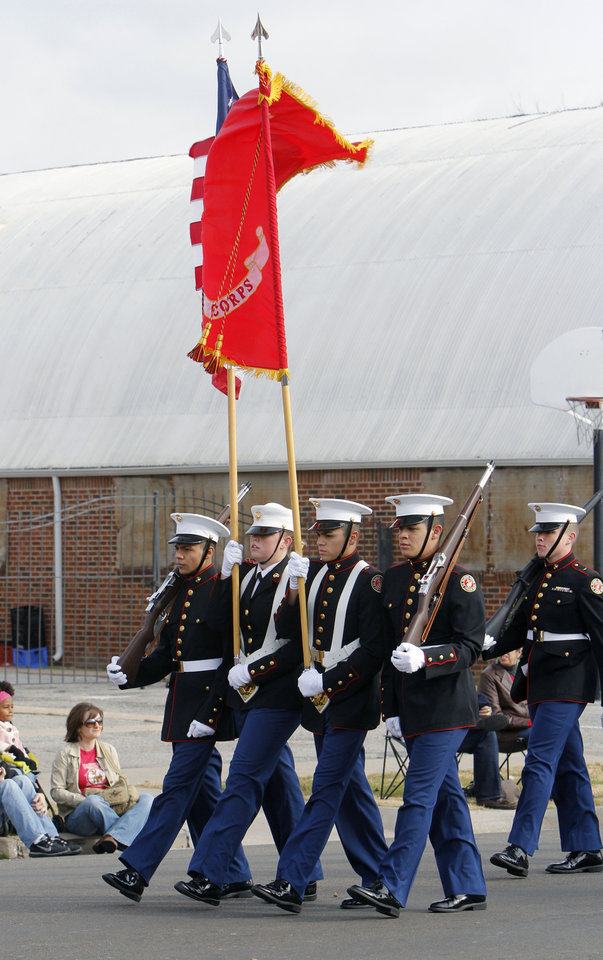 The US Grant High School Marine Corps JROTC marches in the Stockyards City Christmas parade in Oklahoma City, OK, Saturday, December 1, 2012,  By Paul Hellstern, The Oklahoman