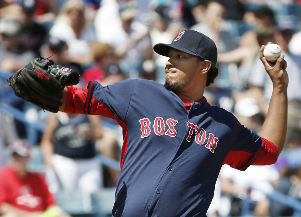 Photo - Boston Red Sox starting pitcher Felix Doubront delivers in the third inning of a spring exhibition baseball game against the New York Yankees in Tampa, Fla., Tuesday, March 18, 2014.  Doubront allowed seven runs on ten hits with two strikeouts and three walks in the outing as the Red Sox fell to the Yankees 8-1. (AP Photo/Kathy Willens)