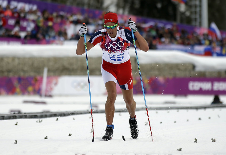 Photo - Norway's Chris Andre Jespersen wears a cut suit as he competes during the men's 15K classical style cross-country race at the 2014 Winter Olympics, Friday, Feb. 14, 2014, in Krasnaya Polyana, Russia. (AP Photo/Gregorio Borgia)