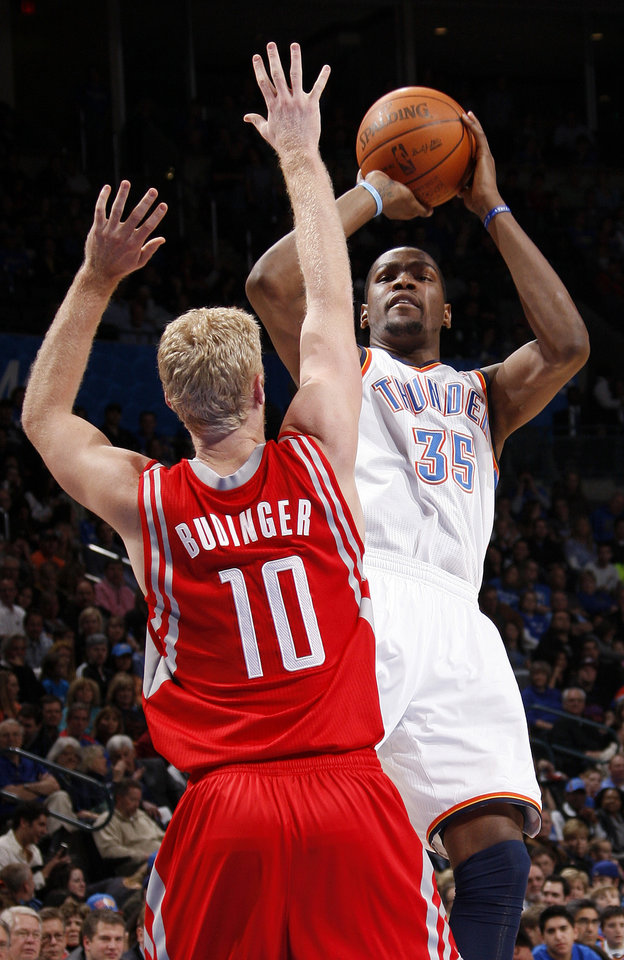 Oklahoma City\'s Kevin Durant (35) takes a shot over Chase Budinger (10) of Houston in the second quarter during the NBA basketball game between the Oklahoma City Thunder and the Houston Rockets at Chesapeake Energy Arena in Oklahoma City, Friday, Jan. 6, 2012. Photo by Nate Billings, The Oklahoman