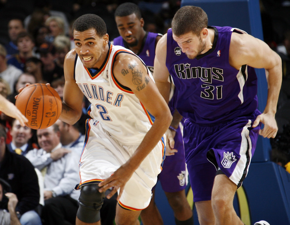 Oklahoma City\'s Thabo Sefalosha (2) dribbles the ball in front of Spencer Hawes (31) of Sacramento during the NBA preseason game between the Sacramento Kings and the Oklahoma City Thunder at the Ford Center in Oklahoma City, Thursday, Oct. 22, 2009. Sacramento won, 104-89. Photo by Nate Billings, The Oklahoman