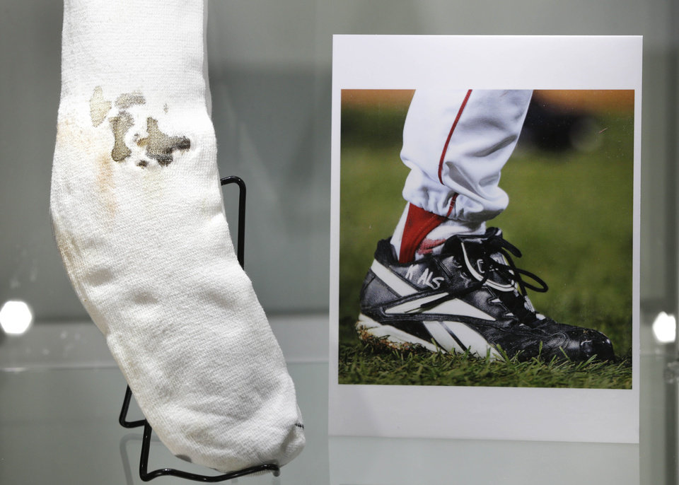 The bloody sock worn by former Boston Red Sox pitcher Curt Schilling in Game 2 of the 2004 World Series is displayed at Heritage Auctions in New York, Thursday, Feb. 21, 2013. Bidding is underway for the sock, which he put up for sale after the high-profile collapse of his video game company. (AP Photo/Seth Wenig)