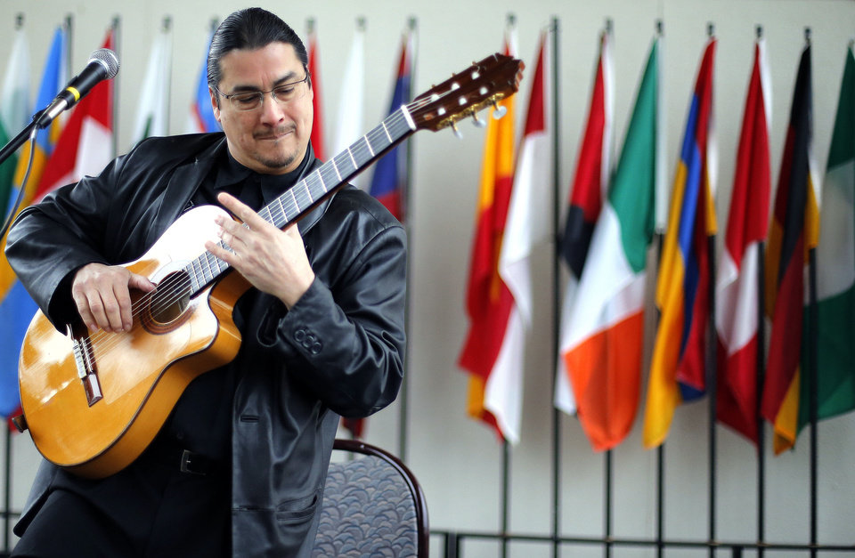 Photo - Edgar Cruz plays during the Global Oklahoma, A festival of cultures, at Rose State College in Midwest City, Saturday, Oct. 6, 2012. Photo by Sarah Phipps, The Oklahoman