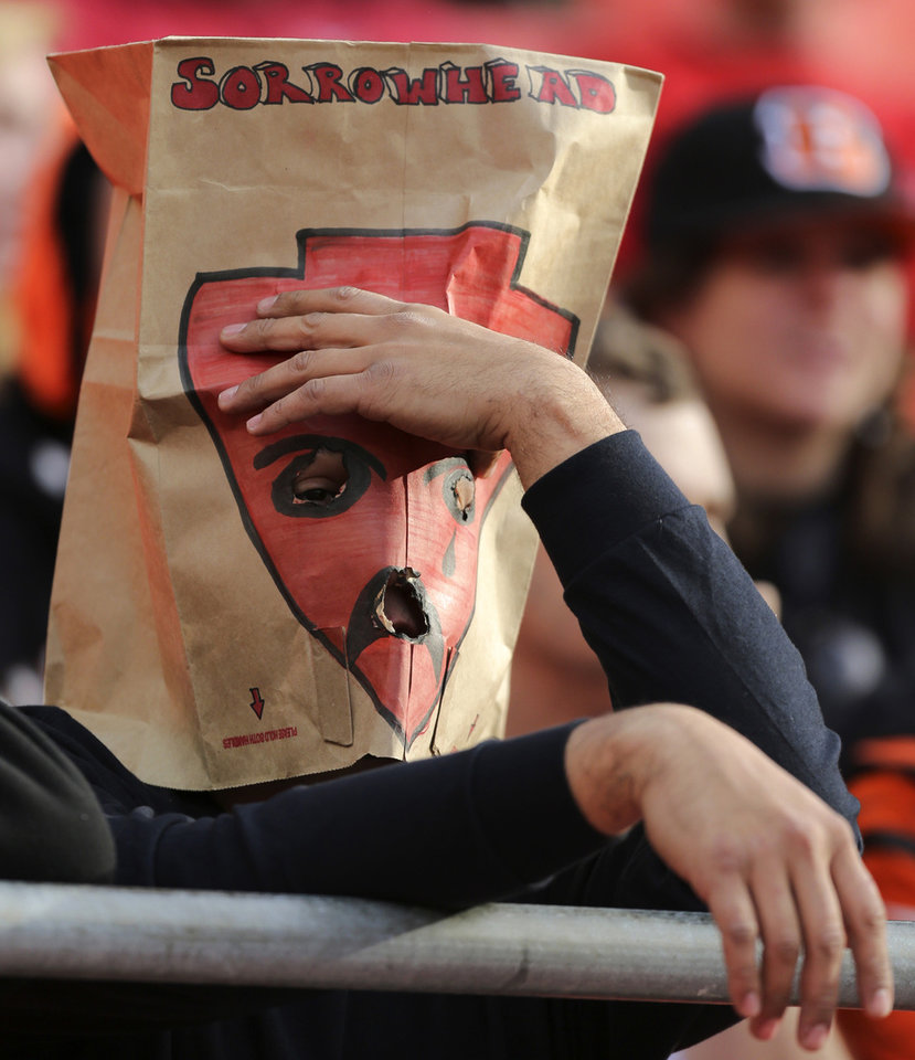 "A Kansas City Chiefs fan wears a paper bag with ""Sorrowhead"" on it over his head as he watches the closing minutes of an NFL football game against the Cincinnati Bengals Sunday, Nov. 18, 2012, in Kansas City, MO. The Bengals won 28-6. The Chiefs have lost seven straight games. (AP Photo/Ed Zurga)"
