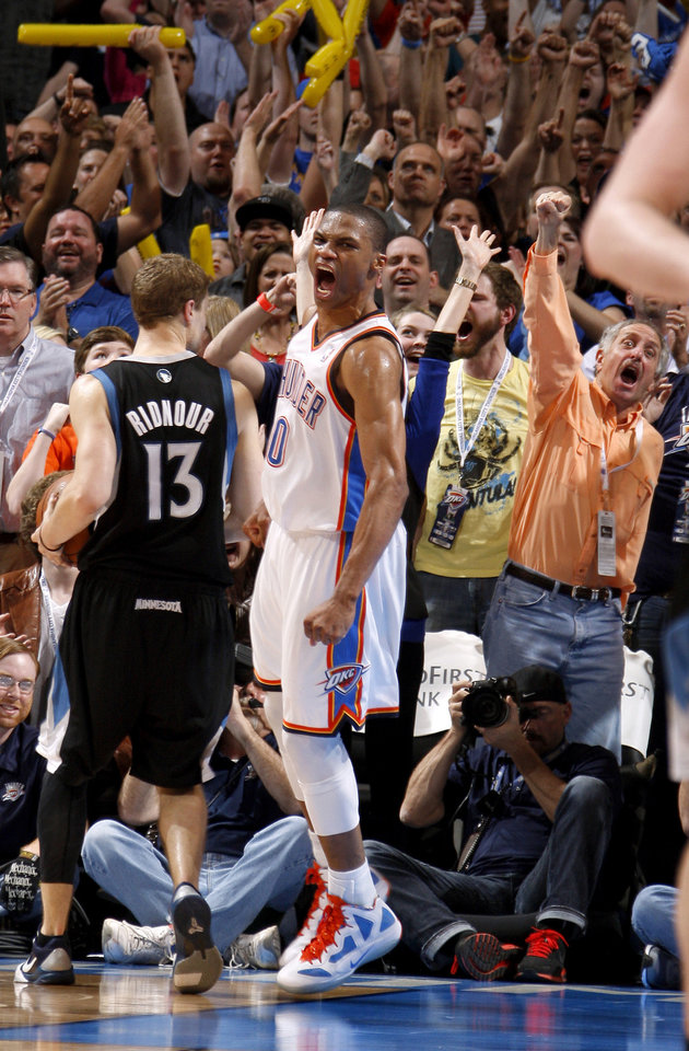 Oklahoma City's Russell Westbrook (0) celebrates beside Minnesota's Luke Ridnour (13) after a dunk in the second overtime during the NBA basketball game between the Oklahoma City Thunder and the Minnesota Timberwolves at Chesapeake Energy Arena in Oklahoma City, Friday, March 23, 2012. Photo by Bryan Terry, The Oklahoman