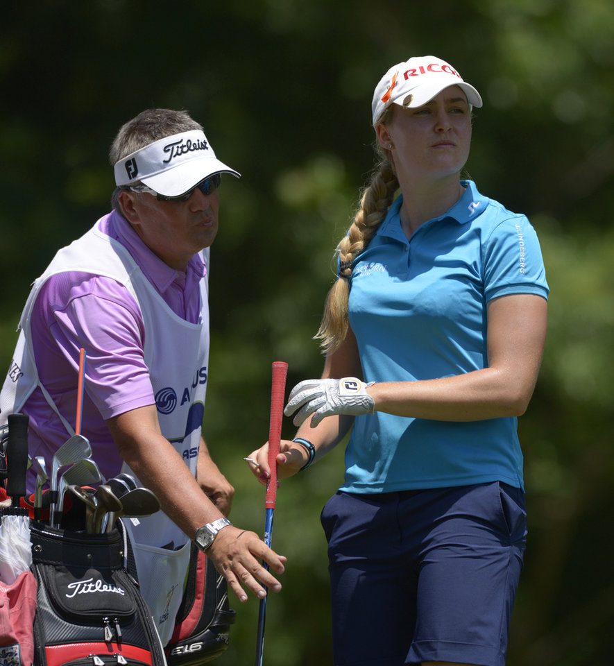 Photo - Charley Hull of England hands her club to her caddy after hitting her tee shot on the seventh hole during the second round of the Airbus LPGA Classic golf tournament at Magnolia Grove on Friday, May 23, 2014,  in Mobile, Ala. (AP Photo/G.M. Andrews)