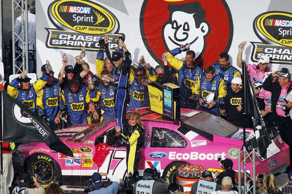 Matt Kenseth celebrates in Victory Lane after winning the NASCAR Sprint Cup Series auto race at Talladega Superspeedway in Talladega, Ala., Sunday, Oct. 7, 2012. (AP Photo/Butch Dill)