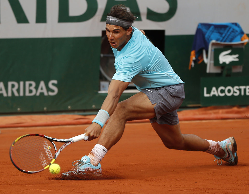 Photo - Spain's Rafael Nadal returns the ball to Serbia's Novak Djokovic during their final match of  the French Open tennis tournament at the Roland Garros stadium, in Paris, France, Sunday, June 8, 2014. (AP Photo/Michel Euler)