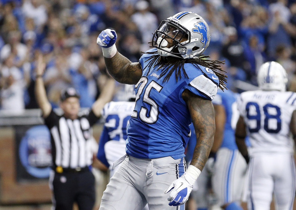 Photo - Detroit Lions running back Mikel Leshoure (25) reacts after scoring a touchdown during the second quarter of an NFL football game against the Indianapolis Colts at Ford Field in Detroit, Sunday, Dec. 2, 2012. (AP Photo/Rick Osentoski)