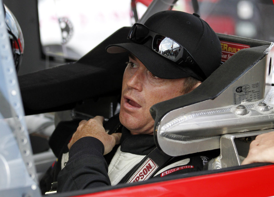 Photo -   Timothy Peters sits in his car waiting to drive qualifying laps for the NASCAR Trucks Series auto race, Friday, Nov. 16 2012 at the Homestead-Miami Speedway in Homestead, Fla. (AP Photo/Terry Renna)