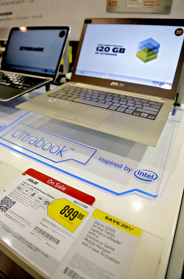 Photo - Best Buy stores are offering deals on computers, hoping to draw parents shopping for back-to-college.  CHRIS LANDSBERGER - CHRIS LANDSBERGER