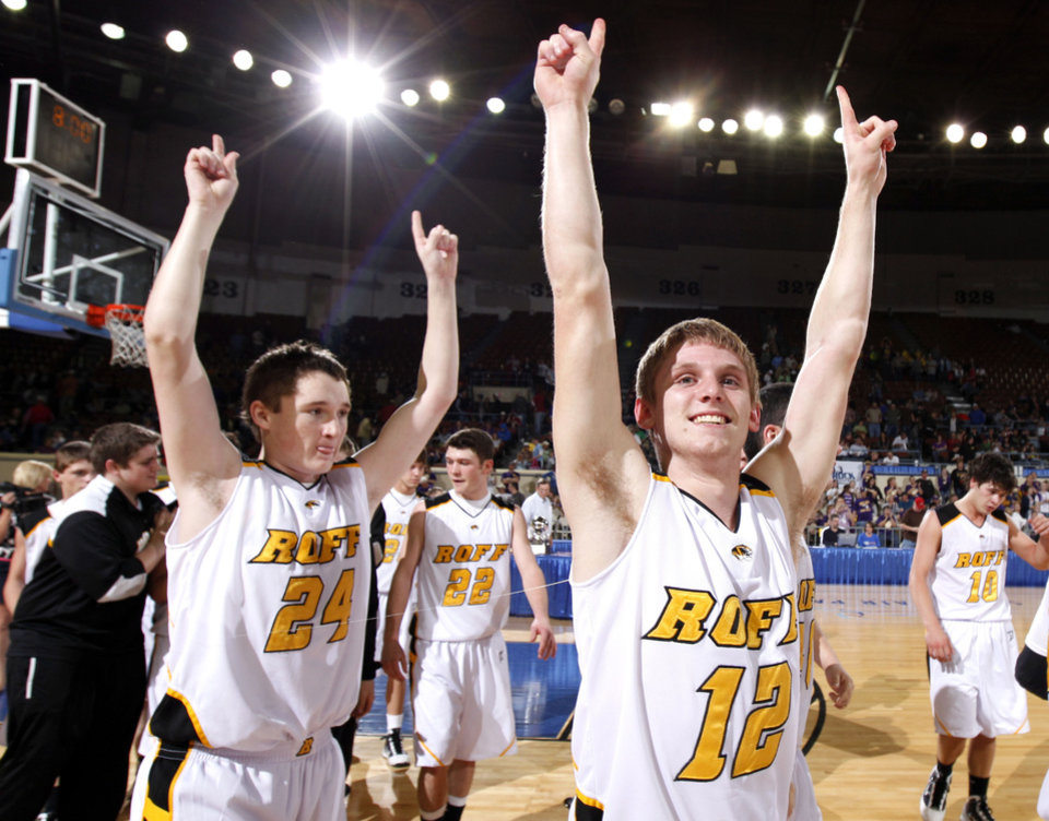 Photo - Roff's Jeremy Grinstead, left, and Josh Coffia celebrate their win over Red Oak during finals of boy's Class B basketball state tournament at the State Fair Arena, Saturday, March 6, 2010, in Oklahoma City. Photo by Sarah Phipps, The Oklahoman