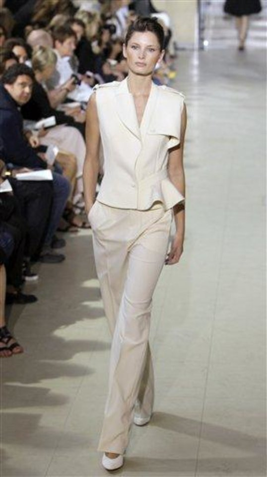 Photo - A model wears a creation by fashion designer Bouchra Jarrar during her Women's Fall Winter 2013 haute couture fashion collection presented at Antoine Bourdelle Museum in Paris, France, Monday, July 2, 2012. (AP Photo/Francois Mori)