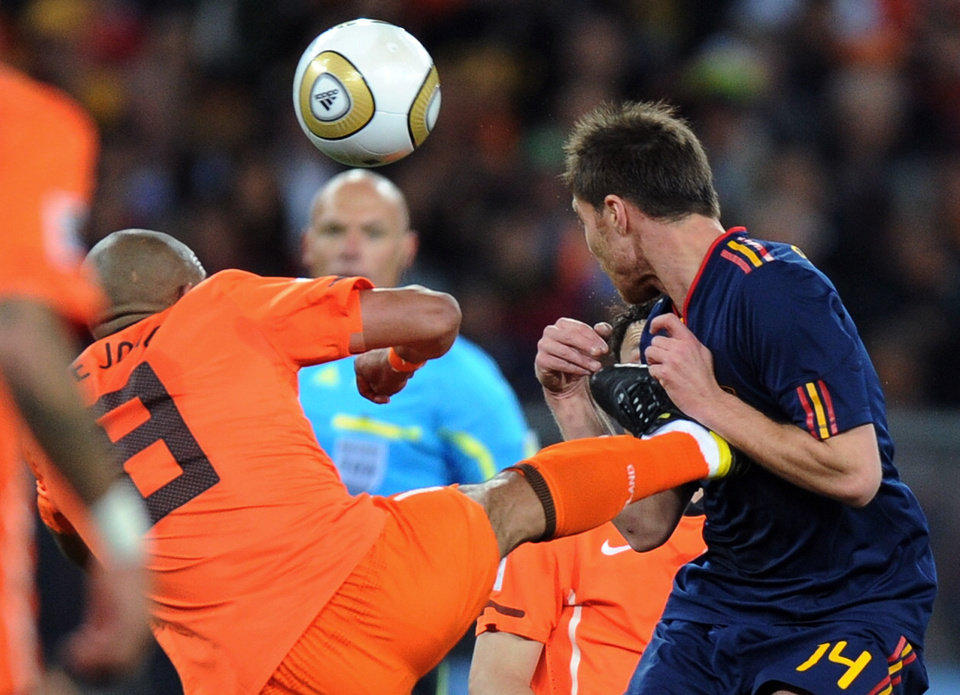 Photo -   FILE - This July 11, 2010 file photo shows Netherlands' Nigel de Jong, left, fouling Spain's Xabi Alonso during a World Cup final soccer match in Johannesburg, South Africa. Violence is part of the game in many sports. But when athletes cross the line it can attract the attention of authorities _ sometimes from within their sport and in other cases from criminal prosecutors. The punishment of four members of the New Orleans Saints for participating a cash-for-hits bounty system targeting opponents is the latest example but not the only one.(AP Photo/Daniel Ochoa de Olza, FIle)