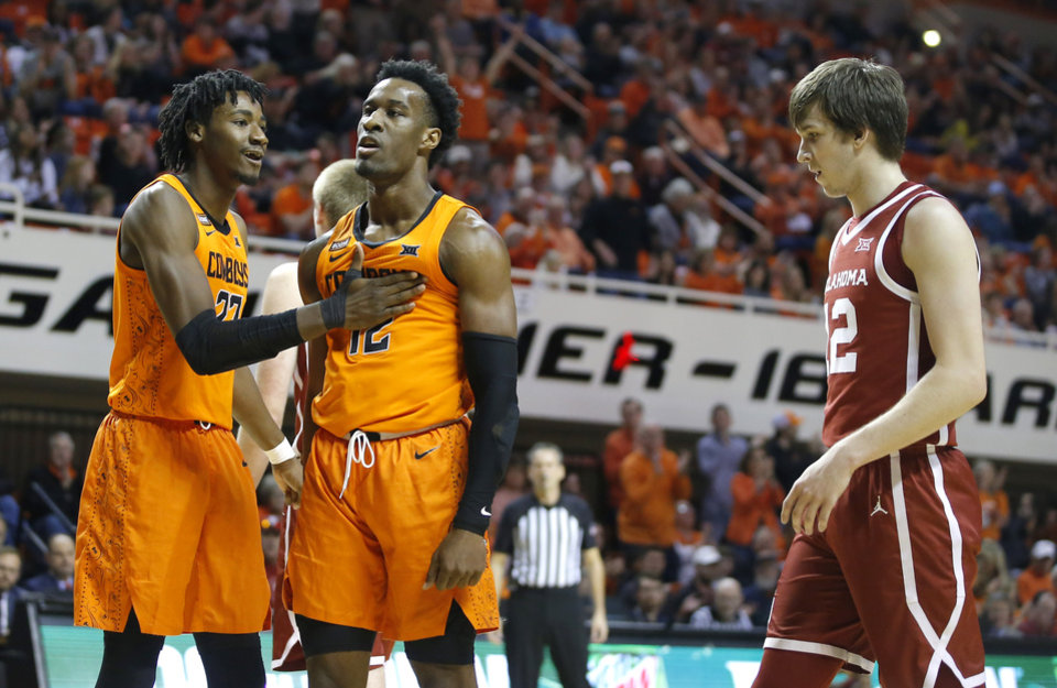 Photo - Oklahoma State's Kalib Boone (22) and Cameron McGriff (12) celebrate beside Oklahoma's Austin Reaves (12) during an NCAA men's Bedlam basketball game between the Oklahoma State University Cowboys (OSU) and the University of Oklahoma Sooners (OU) at Gallagher-Iba Arena in Stillwater, Okla., Saturday, Feb. 22, 2020. Oklahoma State won 83-66. [Bryan Terry/The Oklahoman]