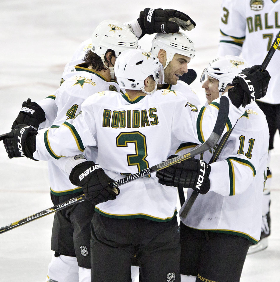 Photo - Dallas Stars' Brenden Dillon (4), Stephane Robidas (3) Eric Nystrom (24) and Derek Roy (11) celebrate Brenden Dillon's goal on the Edmonton Oilers during second period NHL hockey action in Edmonton, Alberta, on Tuesday Feb. 12, 2013. (AP Photo/The Canadian Press, Jason Franson)