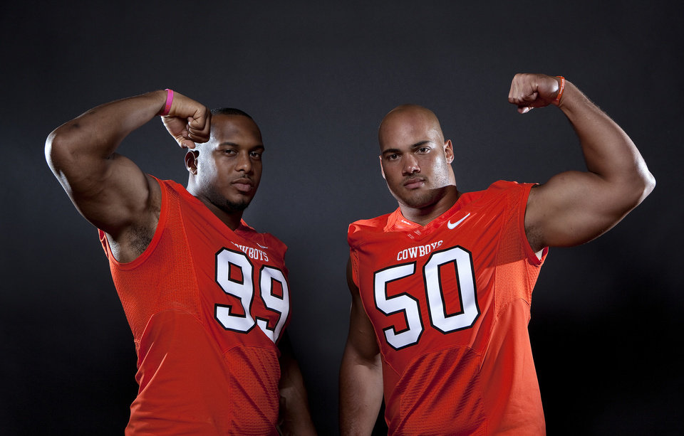 Photo - Oklahoma State's Jamie Blatnick (50) and Richetti Jones (99) pose for a photo during Oklahoma State's Football media day at  in Stillwater, Okla., Saturday, Aug. 6, 2011. Photo by Sarah Phipps, The Oklahoman