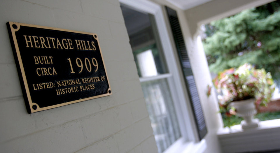 Photo - A sign on the porch of the home of the Sergent family, 514 NW 14, for the Centennial Heritage Hills home and garden tour, in Oklahoma City, Friday, Sept. 28, 2007. By MATT STRASEN, The Oklahoman