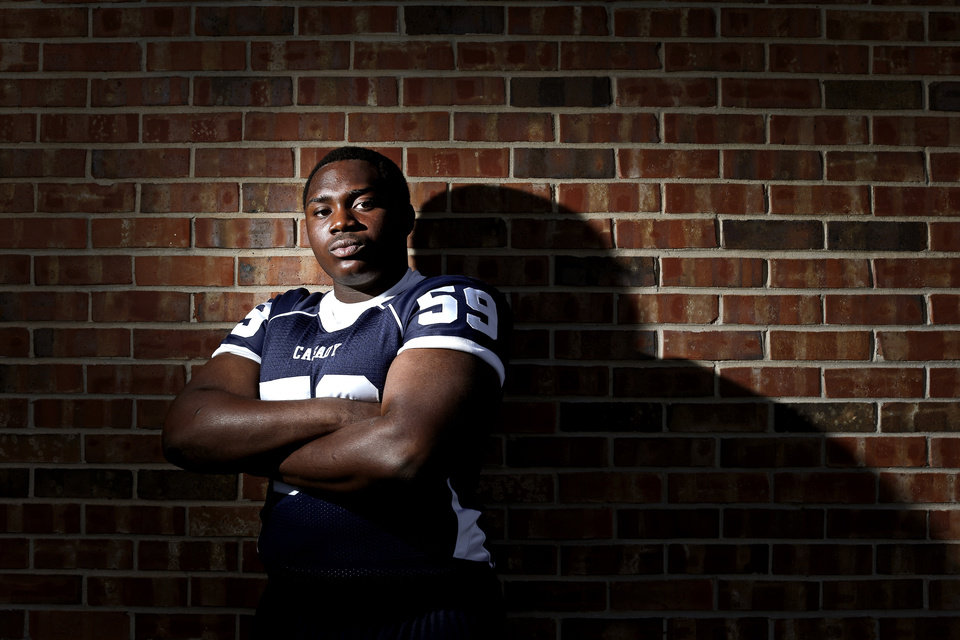 Photo - HIGH SCHOOL FOOTBALL: Casady football player Josh Wariboko-Alali poses for a photo at Casady High School in Oklahoma City, Tuesday, May 15, 2013. Photo by Bryan Terry, The Oklahoman