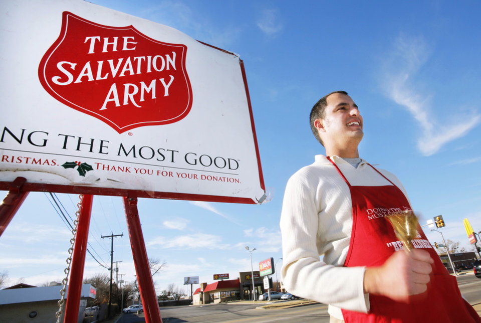 Salvation Army volunteer Adam Bush rings a bell while taking donations outside Byron's Liquor Store in Oklahoma City, Tuesday December 18, 2012. Photo By Steve Gooch, The Oklahoman