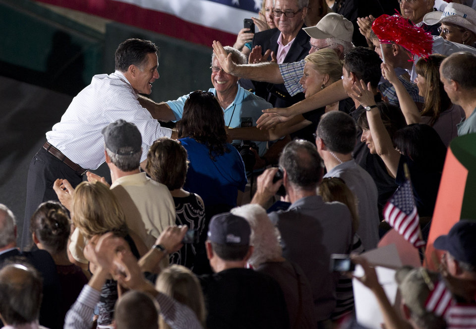 Photo -   Republican presidential candidate, former Massachusetts Gov. Mitt Romney shakes hands during a campaign rally on Friday, Sept. 7, 2012 in Nashua, N.H. (AP Photo/Evan Vucci)