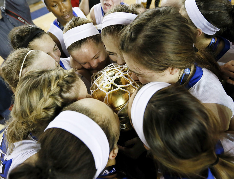 The Deer Creek Antlers kiss the gold ball after the Class 5A girls championship high school basketball game in the state tournament at the Mabee Center in Tulsa, Okla., Saturday, March 9, 2013. Deer Creek defeated Shawnee, 59-44. Photo by Nate Billings, The Oklahoman