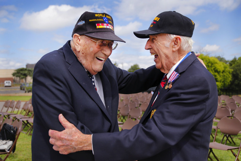 Photo - World War II veterans Donald Wright, 96, left, and Oren Lee Peters, 95, share a laugh as they tell stories after the 45th Infantry Division Museum's Memorial Day Ceremony on Monday, May 30, 2016.     Wright was one of five brothers serving in the war during the 1940s. He was in the US Army and fought in the Pacific Theater in the battle at Guadalcanal. He had an older brother who was killed by enemy fire 11 days after Wright arrived on the island. Wright also had another brother who served with him at Guadalcanal. He retired from the Army with the rank of major.   Peters retired as a lieutenant colonel in the Army. He enlisted into the 179th Infantry Regiment, 45th Infantry Division, Oklahoma U. S. Army National Guard, in January 1939, and was a private first class when, in September 1940, the 45th was activated. 
