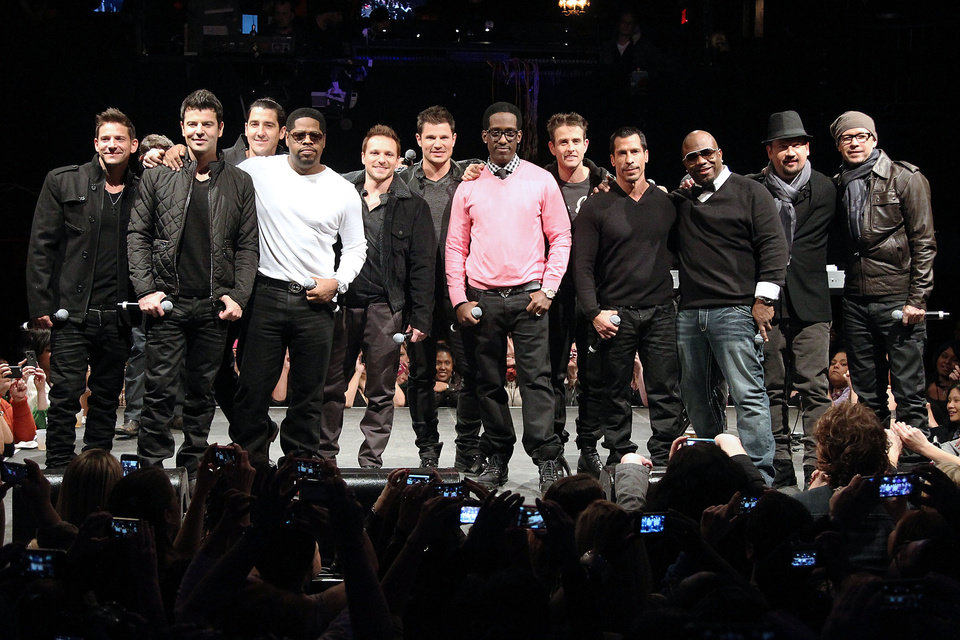 This picture provided by Starpix shows members of 98 Degrees, Boyz II Men, and New Kids on the Block, during the announcement of