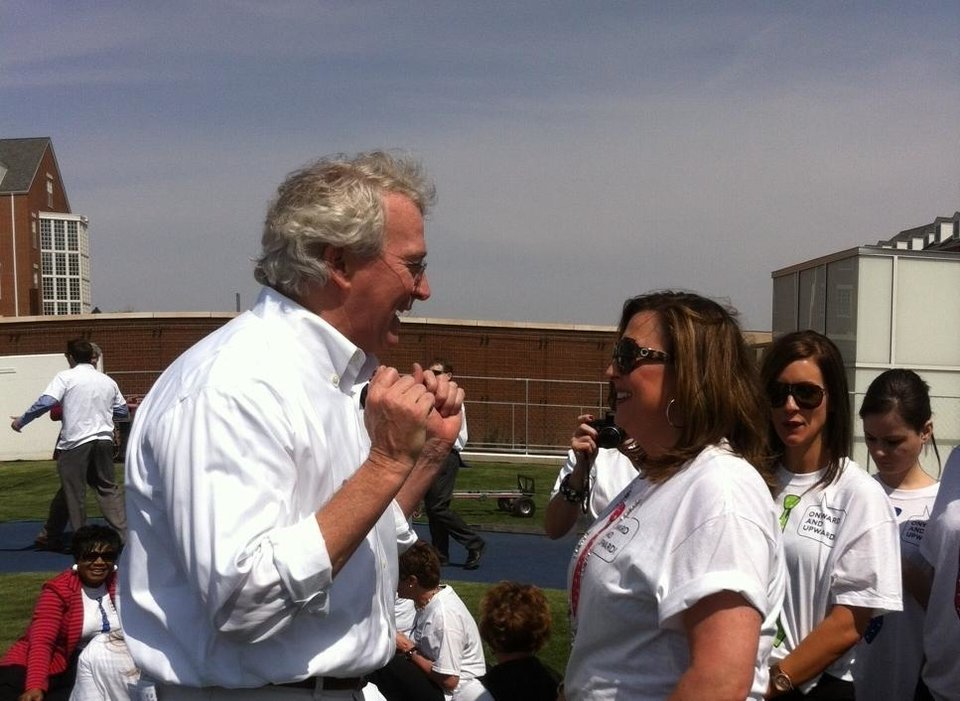 Aubrey McClendon talks to a Chesapeake employee during his farewell party in March at Chesapeake headquarters.