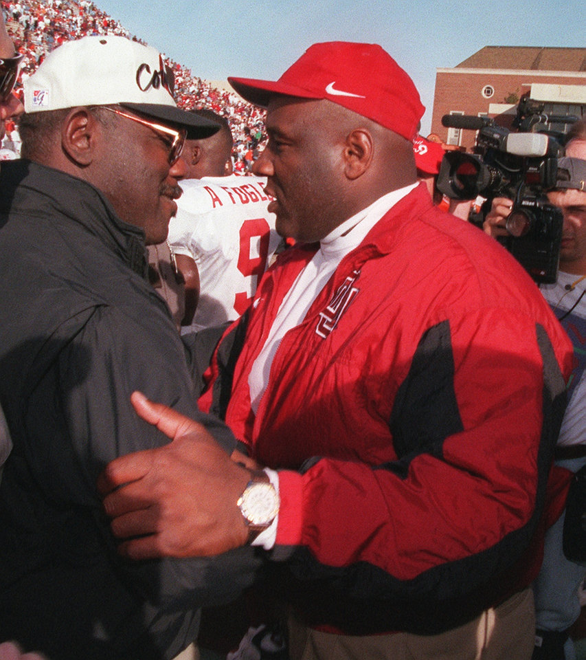 Photo - OSU coach Bob Simmons and OU coach John Blake meet at midfield after the Bedlam college football game on Nov. 9, 1996. OU won, 27-17. Photo by Doug Hoke, The Oklahoman
