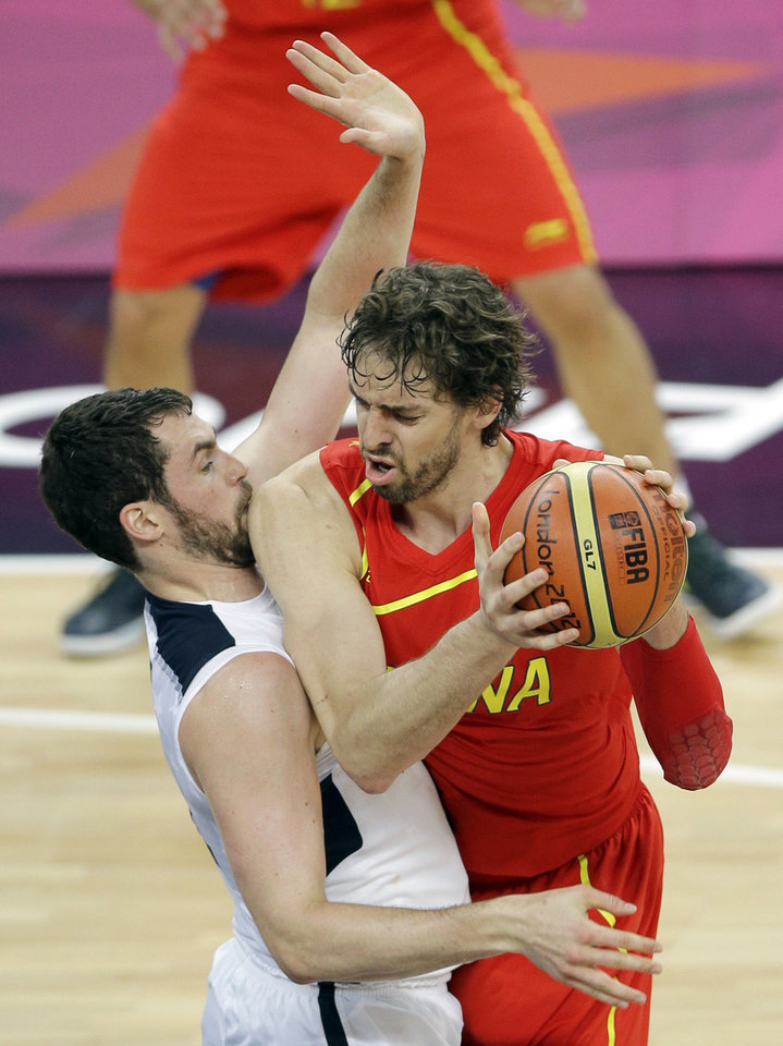 Spain's Pau Gasol is defended by United States' Kevin Love during the men's gold medal basketball game at the 2012 Summer Olympics, Sunday, Aug. 12, 2012, in London. (AP Photo/Matt Slocum)