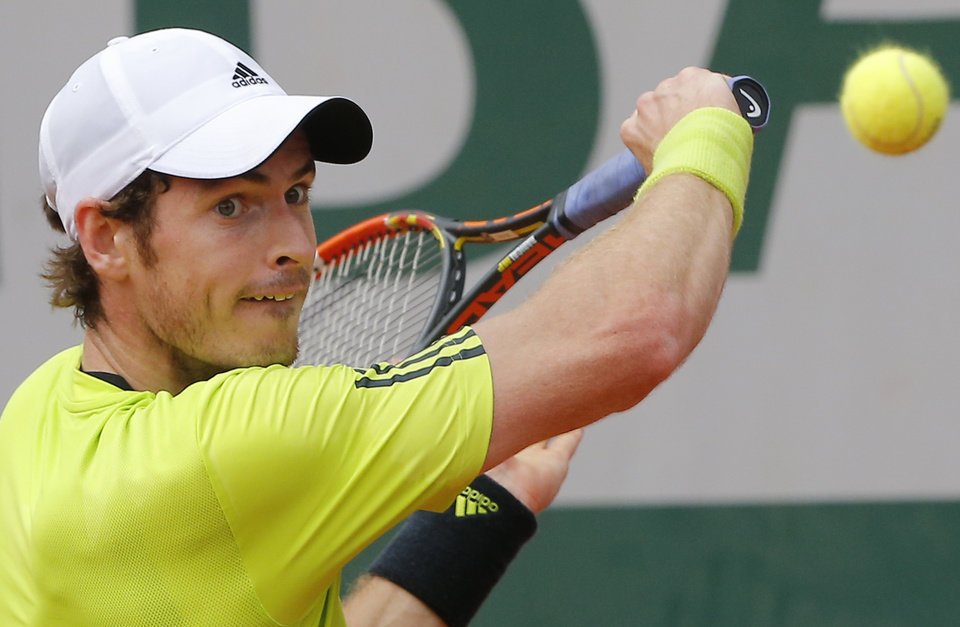 Photo - Britain's Andy Murray returns in his second round match of the French Open tennis tournament against Australia's Marinko Matosevic at the Roland Garros stadium, in Paris, France, Thursday, May 29, 2014. Murray won in three sets 6-3, 6-1, 6-3. (AP Photo/Michel Spingler)