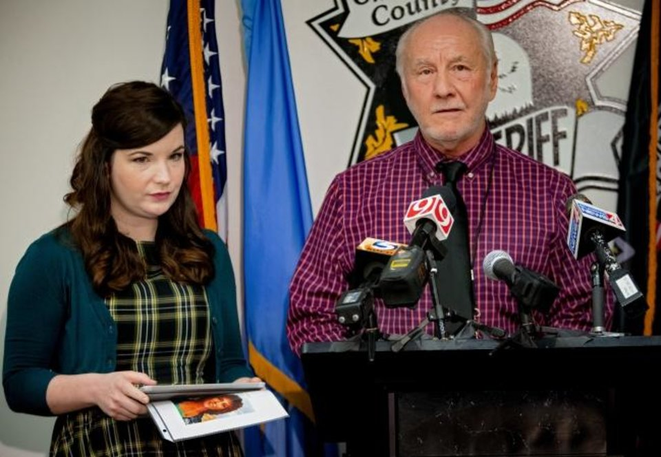 Photo -  DNA Doe Project's Cairenn Binder and Oklahoma County Sheriff's Cpt. Bob Green speak during a press conference to announce the identity of the 1980 cold case homicide victim Tamara Lee Tigard at the Oklahoma County Sheriff's office in Oklahoma City, Okla. on Thursday, Jan. 30, 2020. [Chris Landsberger/The Oklahoman]