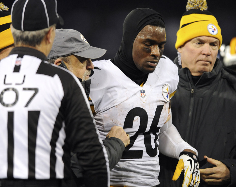 Photo - Pittsburgh Steelers running back Le'Veon Bell is assisted off the field after injuring himself during a play in the second half of an NFL football game against the Baltimore Ravens, Thursday, Nov. 28, 2013, in Baltimore. (AP Photo/Gail Burton)