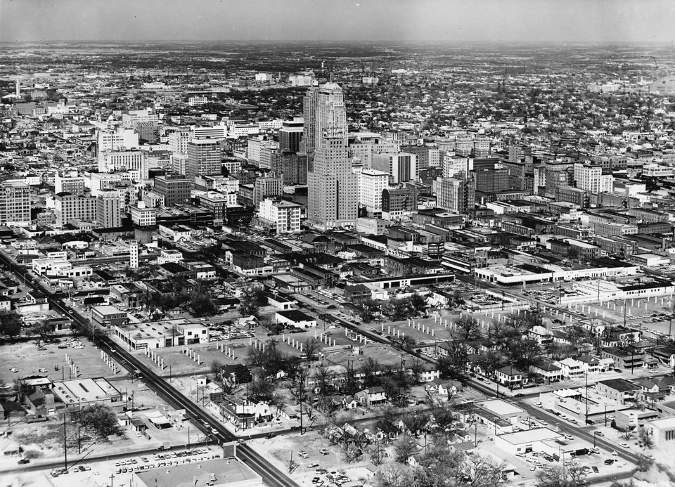 OKLAHOMA CITY / SKYLINE / AERIAL VIEW / I-40 CONSTRUCTION:   Aerial view of downtown Oklahoma City looking northwest from about SW 4 and Walker (intersection in left foreground). Support columns for Crosstown Expressway portion of Interstate 40 through downtown Oklahoma City visible in lower third of photo. Staff photo by Jim Lucas taken 3/11/1964.