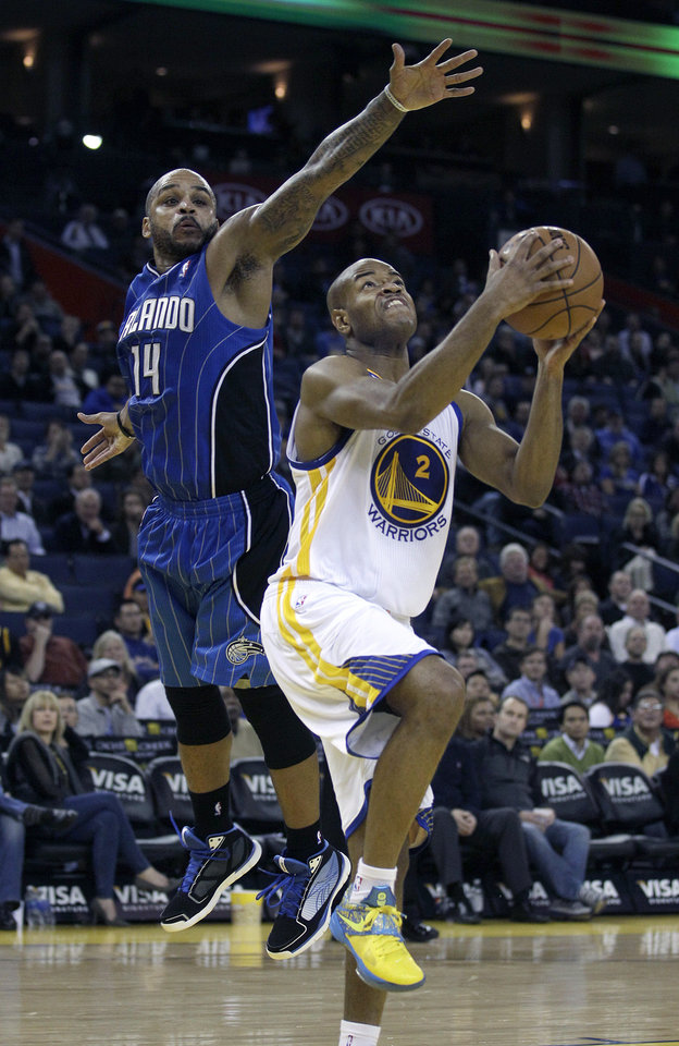 Golden State Warriors point guard Jarrett Jack (2) drives against Orlando Magic point guard Jameer Nelson (14) during the fourth quarter of an NBA basketball game in Oakland, Calif., Monday, Dec. 3, 2012. The Magic won 102-94. (AP Photo/Jeff Chiu)