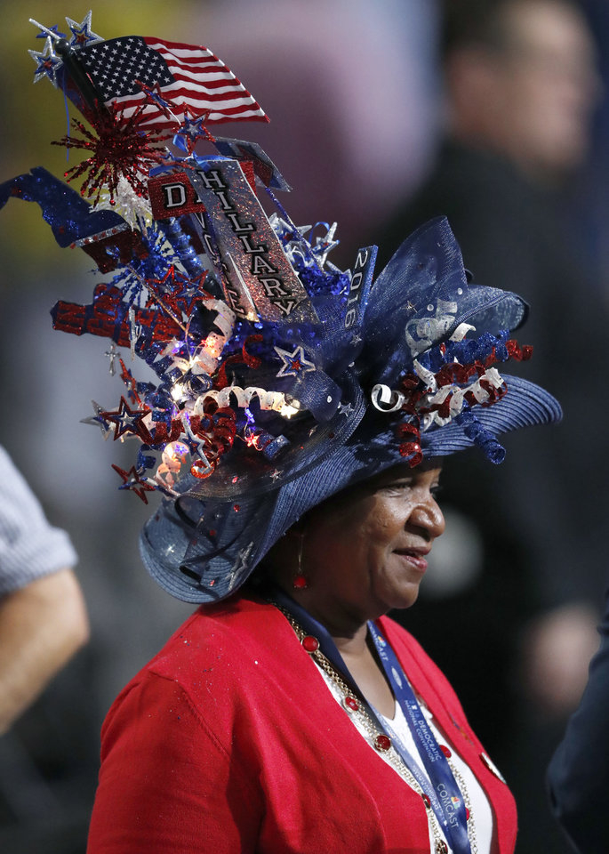 Photo - A woman wears a festooned hat on the floor of the Wells Fargo Center during the first day of the Democratic National Convention in Philadelphia , Monday, July 25, 2016. (AP Photo/Paul Sancya)
