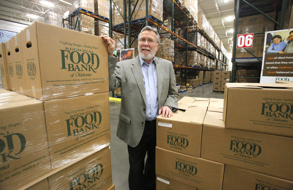 Photo - Rodney Bivens, executive director and CEO of the Regional Food Bank of Oklahoma, in the warehouse at the Regional Food Bank of Oklahoma in Oklahoma City Thursday, Jan. 12, 2012.  Photo by Paul B. Southerland, The Oklahoman