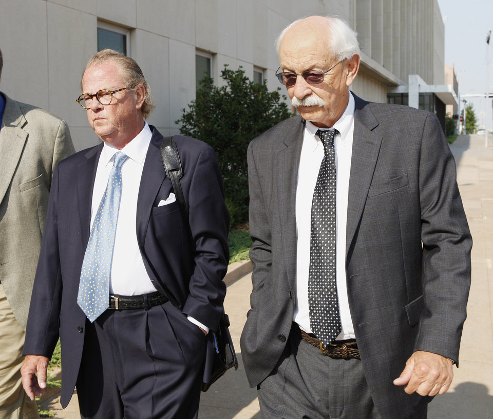 Defense attorney John Coyle and gambler Richard Allen Hancock, right, leave the Oklahoma City federal courthouse Wednesday after his sentencing for illegal gambling. Photo by Paul B. Southerland, The Oklahoman
