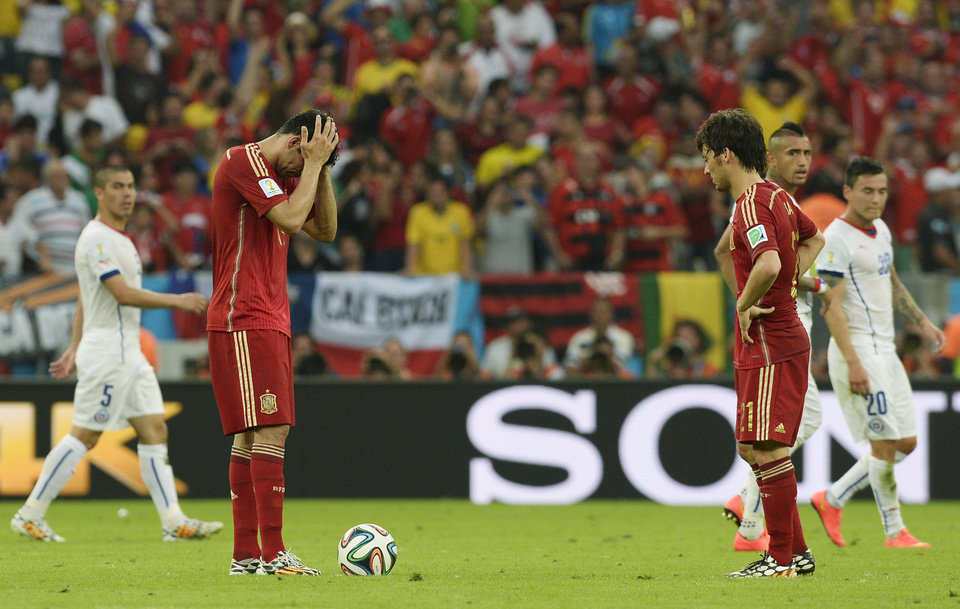 Photo - Spain's Diego Costa, left, and David Silva prepare to kick off after Chile scored their second goal during the group B World Cup soccer match between Spain and Chile at the Maracana Stadium in Rio de Janeiro, Brazil, Wednesday, June 18, 2014.  (AP Photo/Manu Fernandez)
