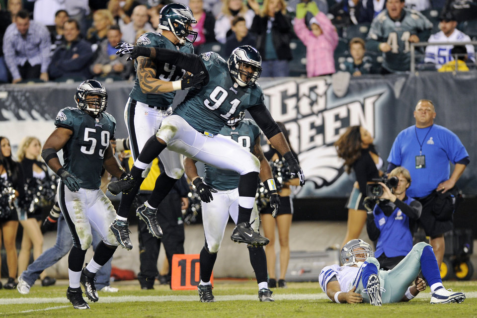Philadelphia Eagles' Fletcher Cox (91), Jason Babin (93) and DeMeco Ryans (59) react after sacking Dallas Cowboys quarterback Tony Romo in the second half of an NFL football game, Sunday, Nov. 11, 2012, in Philadelphia. (AP Photo/Michael Perez)