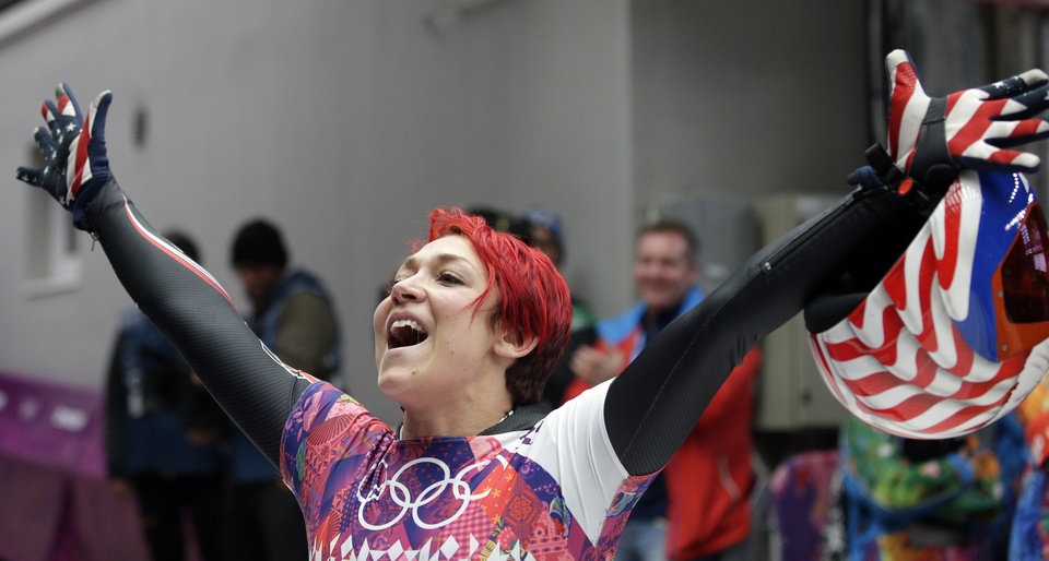 Photo - Katie Uhlaender of the United States waves to fans after her final run during the women's skeleton competition at the 2014 Winter Olympics, Friday, Feb. 14, 2014, in Krasnaya Polyana, Russia. (AP Photo/Michael Sohn)