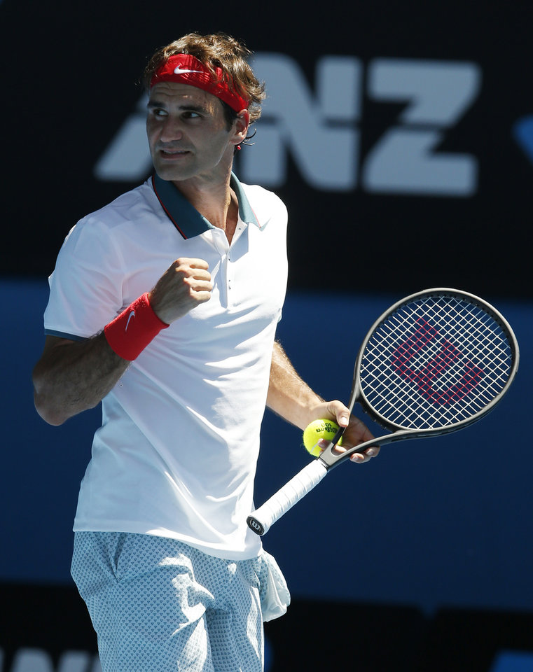 Photo - Roger Federer of Switzerland celebrates his win over James Duckworth of Australia after their first round match at the Australian Open tennis championship in Melbourne, Australia, Tuesday, Jan. 14, 2014.(AP Photo/Eugene Hoshiko)