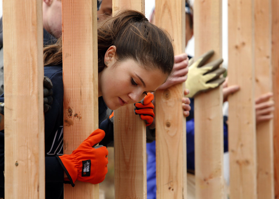 Marie-Elena Cronin of Haddonfield, N.J., helps frame a house for Joel and Bettie Spears in Bethel Acres. PHOTO BY STEVE SISNEY, THE OKLAHOMAN <strong>STEVE SISNEY</strong>