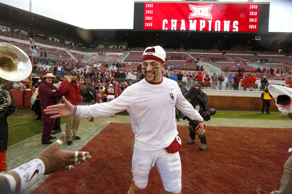 Photo - Oklahoma's Baker Mayfield celebrates after the Bedlam college football game between the Oklahoma Sooners (OU) and the Oklahoma State Cowboys (OSU) at Gaylord Family - Oklahoma Memorial Stadium in Norman, Okla., Saturday, Dec. 3, 2016. Oklahoma won 38-20. Photo by Bryan Terry, The Oklahoman