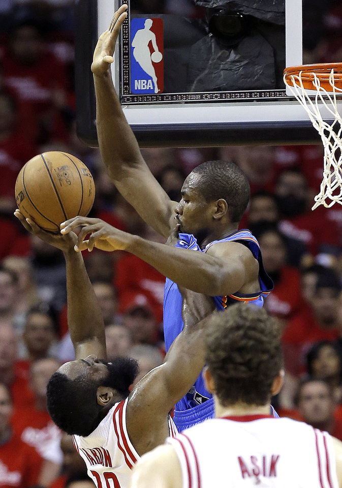 Oklahoma City\'s Serge Ibaka (9) deeds against Houston\'s James Harden (13) during Game 4 in the first round of the NBA playoffs between the Oklahoma City Thunder and the Houston Rockets at the Toyota Center in Houston, Texas, Monday, April 29, 2013. Photo by Bryan Terry, The Oklahoman