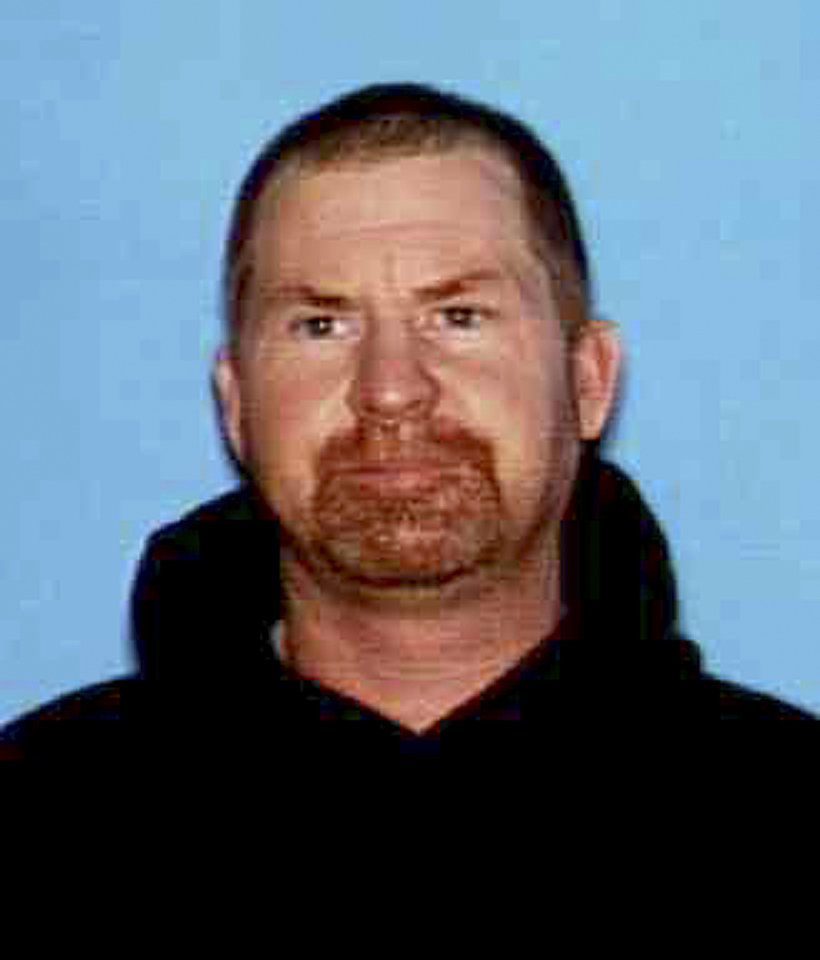 This undated photo released by the Shasta County Sheriff\'s office shows Shane Miller, 45, who is suspected of a triple homicide at his home in rural Northern California. Shasta County Sheriff\'s Lt. Tom Campbell said Miller remained on the loose on Wednesday, May, 8, 2013, a day after the killings six miles west of Shingletown. (AP Photo/Shasta County Sheriff)